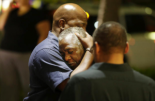 Mourners at vigil in Charleston via David Goldman/AP Photo